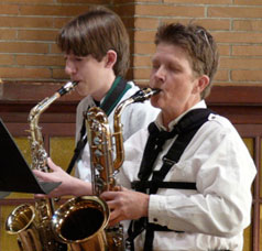 Kate playing baritone sax in a quartet